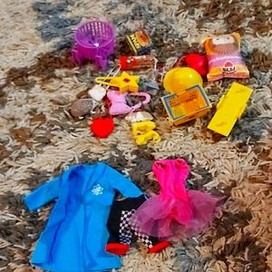 I'm selling Barbie doll clothes and accessories